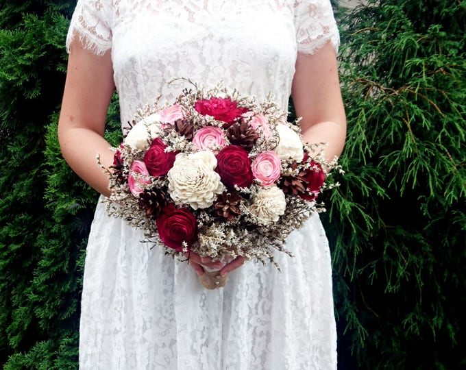 Burgundy and pink sola flowers bouquet with pine cones dried flowers burlap lace rustic woodland wedding big bridal maroon blush marsala