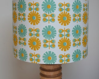 Handmade lampshade using Scandinavian inspired repeated daisy flower pattern in pale teal and mustard