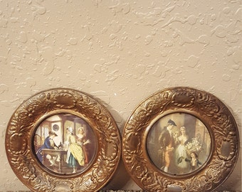 Small vintage brass wall plates with English scenes framed in the center.  Made in England.  Beautifully aged.