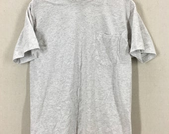 Vintage 80's Gray Pocket T-Shirt Fits like a Medium 50/50 USA