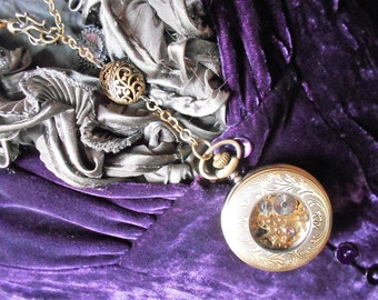 Mechanical Pocket Watch necklace and the octopussy.