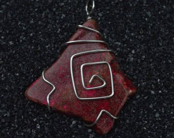 Wire wrapped red stone bead