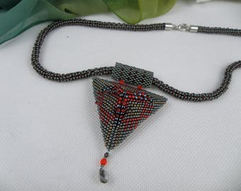 A beaded pendant ,triangle necklace