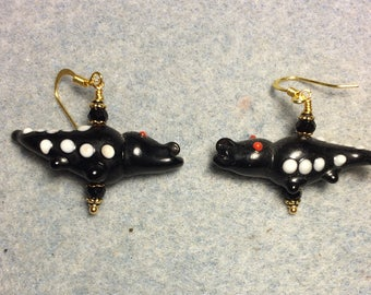 Black lampwork alligator bead earrings adorned with black Chinese crystal beads.