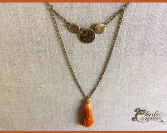 Double rows of bronze and tassel necklace made entirely by hand.