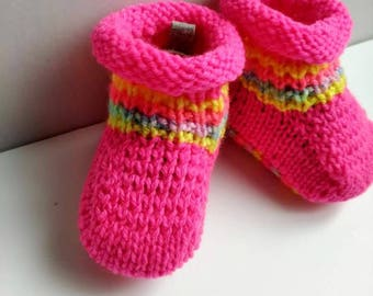 Neon pink booties for a little girl