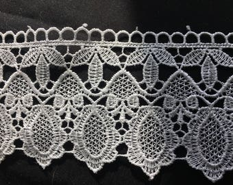 White floral lace, polyester embroidered design. 6.5 cm wide. WH095