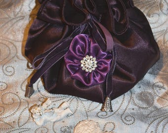 Beautiful Plum satin pouch and a flower attached to the heart of rhinestones
