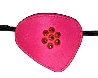 concarve leather eyepatch in pink with golden  spikes