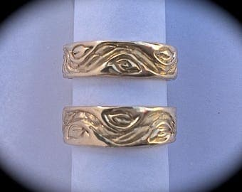 Fallen leaves along the river wrap all around these custom wedding bands in 14k or 18k gold!