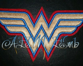 Sew On Wonder Woman Patch Gold with Blue Stitching and Red back ground