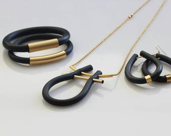 Geometric Necklace jewelry. Modern simple jewelry.  Rubber U shape necklace. Matt gold plated necklace. Handmade necklas.