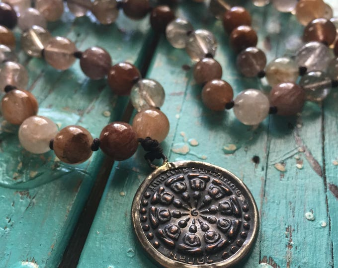 108 Bead Handknotted Spiritual Junkies Red and Gold Rutilated Quartz + Thai Buddha / Dharma Wheel Yoga and Meditation Mala