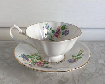 Queen Ann tea cup and saucer, white with gold trim and flowers