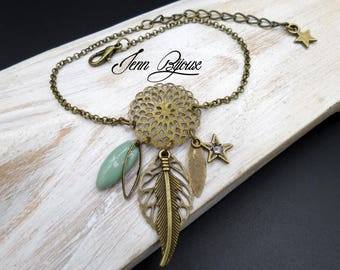 Dream bracelet, made in light green and bronze metal and charms