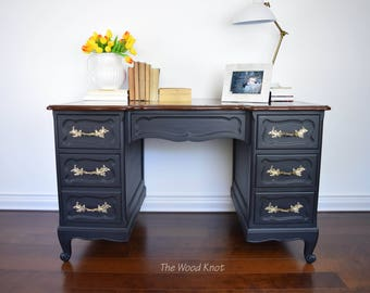 French provincial black desk with leather top.