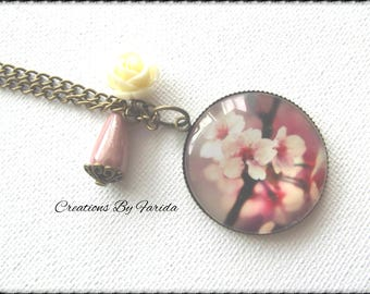 Bronze necklace with cabochon backed color cherry blossom pattern