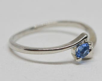 Lovely silver tone and blue stone ring