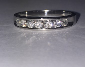 Channel Set Diamond Band in 18K White Gold. Total Diamonds' Weight: 0.50ct.