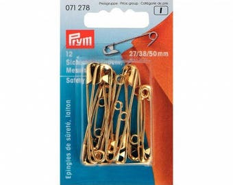 Assorted gold safety pins