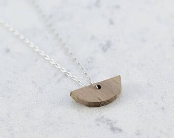 Half moon shaped necklace made of walnut wood,