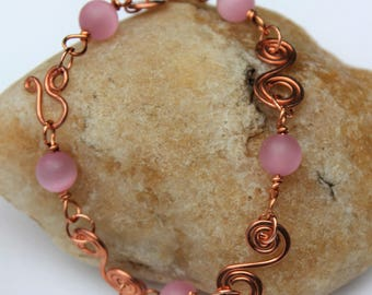 Hammered copper, Copper wire bracelet, spiral links, hook clasp, cat's eye matte pink glass bead, copper wire