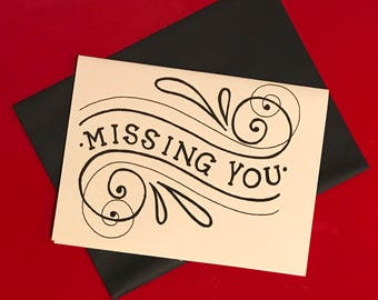 black and white hand lettered missing you card