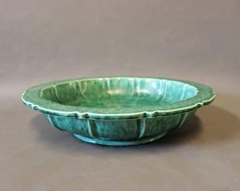 Dark green ceramic bowl, stamped XS.
