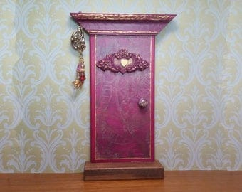 Indoor Magenta Fairy Door with Heart Scroll Embellishment and Fairy Wind Chime