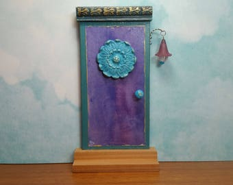 Indoor Mauve Fairy Door with Turquoise Medallion and Fairy Porch Light
