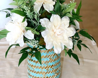 Teal & mirrored vase filled with greenery and white flowers