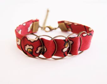 Liberty bracelet red orange and mustard yellow and bronze rings brass