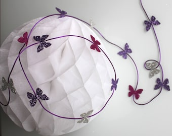 2 m Garland of 14 butterflies with glitter in various colors (gray, purple, fuchsia)