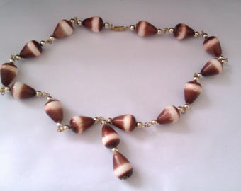 brown and white plastic bead necklace