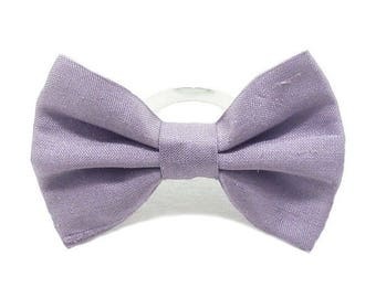 Silk purple fabric bow ring.