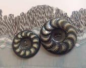 2 Celluloid Buttons. Buff...