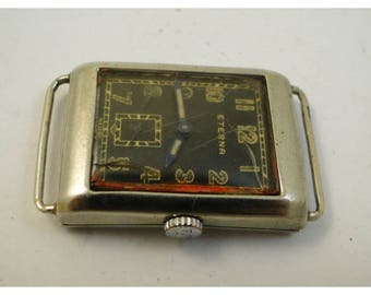 rare all steel eterna made in switzer black gild dial mens are deco watch runs great all original 1930's
