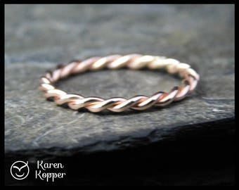 Minimalist twisted ring, made from 14k solid rose gold wire, made at your size. wedding band, engagement ring, stacking ring.