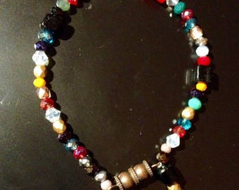 Bracelet with multicolored Crystal beads and Czech glass and black stone beads