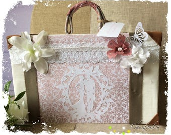 wedding vintage urn shaped suitcase that can be attached to a guest book
