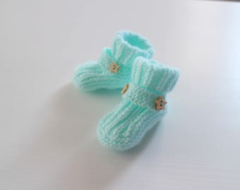 Knitted baby booties. 1 pair