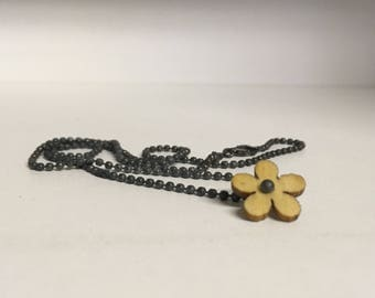 Black oxidized silver necklace with wooden flower.