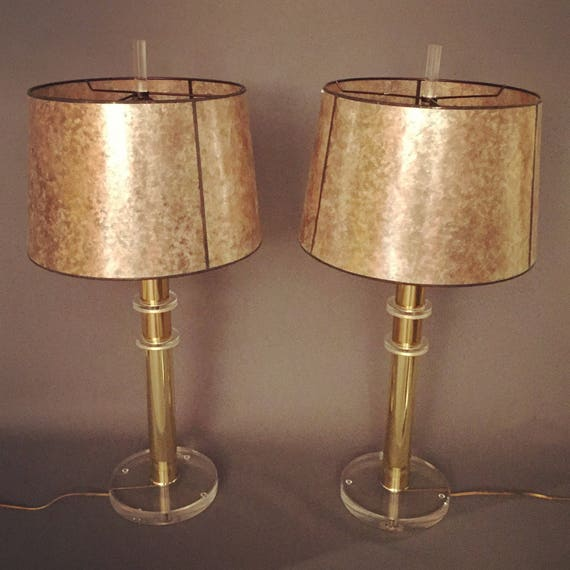 Hollywood regency pair of Lucite table lamps