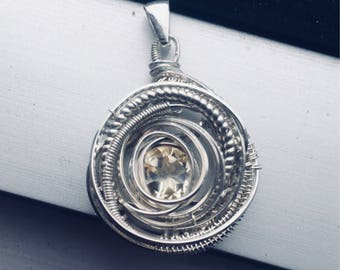 Round faceted citrine wire wrapped pendant