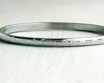 Slim Roman numeral bracelet