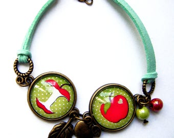 Green bracelet with 2 red apples with charms and beads