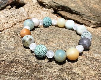 Diffuser bracelet with a light blue/green lava stone, Amazonite, and Quartz