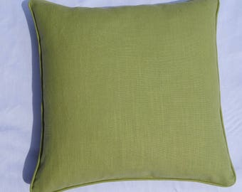 Plain cushion cover in soft celery green colour with piped edges.