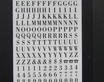 360 white rectangular stickers 0, 7 x 0, 9mm with black numbers and alphabet