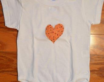 Heart shaped print fabric applique onesie.